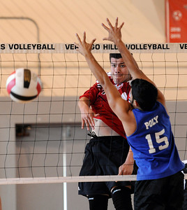 Verdugo Joe Arechiga (27) hits the ball as Poly's Kevin Avelar (15) defends during their boys volleyball match at Verdugo Hills High School in Tujunga Monday, April 9, 2012. (Hans Gutknecht/Staff Photographer)