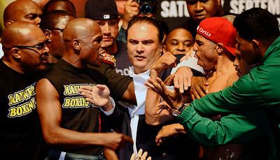 (C) Boxing promoter Richard Schaefer) tries to break up Floyd Mayweather Jr.(L) and  Victor Ortiz  during the weigh in today, as both will fight for the WBC welterweight title this Saturday night at the MGM grand hotel in Las Vegas.  Sept 16,2011. Photo by Gene Blevins/LA Daily News