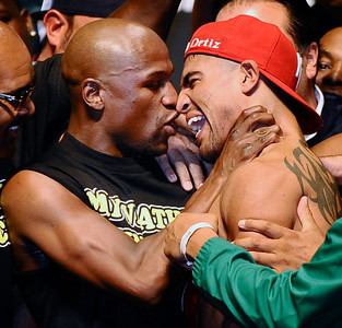 (L) Floyd Mayweather Jr. grabs Victor Ortiz's neck during the weigh in today, as both will fight for the WBC welterweight title this Saturday night at the MGM grand hotel in Las Vegas.  Sept 16,2011. Photo by Gene Blevins/LA Daily News