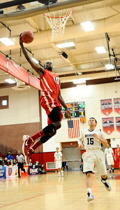 Village Christian #10 Marquis Salmon makes a slam dunk shot as they take win 58-57 over Renaissance Academy for the CIF championship in Southern California Div. V boys' basketball regional finals. Ontario CA. March 17.2012. Photo by Gene Blevins/LA DailyNews