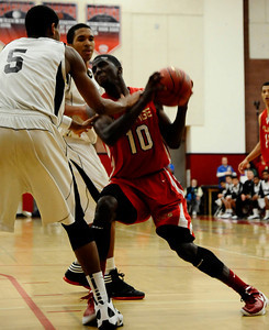 Village Christian #10 Marquis Salmon fight for control of the ball, as they take win 58-57 over Renaissance Academy for the CIF championship in Southern California Div. V boys' basketball regional finals. Ontario CA. March 17.2012. Photo by Gene Blevins/LA DailyNews