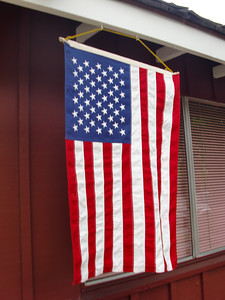 An American flag hangs next to the residential garage that serves as a polling place on the corner of Hatteras Street and Tyrone Avenue in Sherman Oaks on Tuesday, June 8, 2010. (Steven Rosenberg/Daily News)