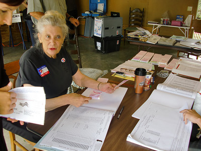 Poll worker Marty Verhaeghe of Sherman Oaks checks a voter's information in the residential garage that serves as a polling place on the corner of Hatteras Street and Tyrone Avenue in Sherman Oaks on Tuesday, June 8, 2010. (Steven Rosenberg/Daily News)