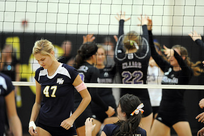 West Ranch's Angelica Rutledge walks away from the net as Valencia players celebrate a point during their match at West Ranch High School in Stevenson Ranch, CA Thursday, November 4, 2010. (Hans Gutknecht/Staff Photographer)