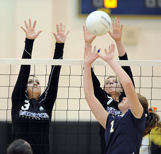 West Ranch's Janelle Futch sets the ball as Valencia's Alexa Schmidt and Serena LeDuff defend  during their match at West Ranch High School in Stevenson Ranch, CA Thursday, November 4, 2010. (Hans Gutknecht/Staff Photographer)