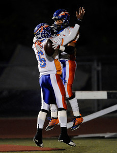 Westlake's Justin Moore (6) congratulates Dashon Hunt (9) after Hunt scored a touchdown during their playoff game against Hart at College of the Canyons in Santa Clarita Friday, November 25, 2011. (Hans Gutknecht/Staff Photographer)