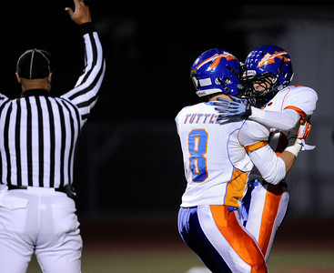Westlake's Connor Cook (15) celebrates with Cody Tuttle (8) after Cook scored a touchdown during their playoff game against Hart at College of the Canyons in Santa Clarita Friday, November 25, 2011. (Hans Gutknecht/Staff Photographer)