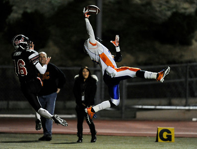 Westlake's Dashon Hunt (9) breaks up a pass in the end zone intended for Hart's Trent Irwin (16) during their playoff game at College of the Canyons in Santa Clarita Friday, November 25, 2011. (Hans Gutknecht/Staff Photographer)