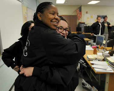 ACADECA coach Stephanie Franklin gives a hug to Amanda Fitzmorries after she completed an exam. El Camino Real is among the elite competitors in the Academic Decathlon, having won numerous state and national titles. Now the program is in jeopardy due to budget cuts within the LAUSD. Woodland Hills, CA 3/08/2012(John McCoy/Staff Photographer)