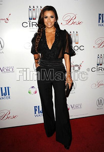 Actress Eva Longoria wears a sheer pointelle lace blouse with black silk trousers from from Zuhair Murad's Fall/Winter Collection at an Oscar week event at her restaurant, Beso Hollywood, on Feb. 22, 2012.
