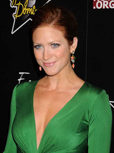 Actress Brittany Snow wears Isharya Nile Nymph long cluster earrings, Isharya Modern Maharani Florentine stackable rings and a Paula Crevoshay 18K gold ring with orange moonstone and garnet to the Hollywood Domino Gala & Tournament at the Sunset Tower Hotel on Feb. 23, 2012.