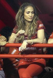 Jennifer Lopez wears Norman Silverman jewelry including 18K white gold diamond hoops and 18K yellow gold diamond bangles to the Brahma at Rio de Janeiro's carnival on Feb. 19, 2012.