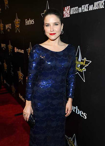 Actress Sophia Bush wears Brumani Baobab earrings in 18K yellow gold with brown diamonds, aquamarine, ruby and pink tourmaline and a matching ring to the Hollywood Domino Gala & Tournament at the Sunset Tower Hotel on Feb. 23, 2012.