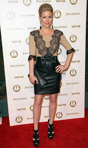 Actress Kathleen Robertson wears a Maria Lucia Hohan Chrystine nude bodysuit with black lace applique and a Maria Lucia Hohan Elisa black leather skirt with bow detail at Vanities anniversary party at Siren Studios in Hollywood on Feb. 20, 2012. Robertson accessorizes with Vanessa Leu 18K black gold earrings with black onyx and black pave diamonds.
