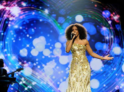 Singer Kelly Rowland wears a Jack Guisso gown to the Power of Love gala celebrating Muhammad Ali's 70th birthday at the MGM Grand Garden Arena in Las Vegas on Feb. 18, 2012.