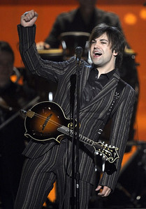 Singer Neil Perry of The Band Perry wears an Anthony Franco striped suit from the Spring 2012 Men's Collection to perform at Lionel Richie Friends in Concert in Las Vegas on April 2, 2012.