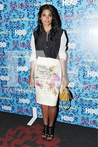 """Designer Rachel Roy wears her own black and white washed silk pin-tuck blouse with an Iced lemon floral duchess satin ikat placement pencil skirt and Givenchy heels to the premiere of HBO's """"Girls"""" in New York City on April 4, 2012."""