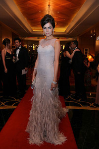Actress Camilla Belle wears Norman Silverman jewelry including a diamond bracelet and two 18K white gold full-cut diamond bands at the Formula One Grand Prix Ball in Kuala Lumpur on March 22, 2012.