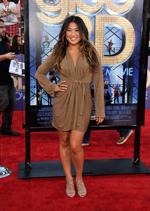 """Actress Jenna Ushkowitz wears Bavna silver and gold cut-out pear-shaped earrings with diamonds and an Isharya Florentine stone ring with enamel to the premiere of """"Glee: The 3D Concert Movie"""" at the Regency Village Theatre on Aug. 6, 2011."""