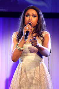 Singer Jennifer Hudson wears Vahan a 14K yellow gold diamond knot ring and Isharya Florentine stackable bangles in black and blue enamel to the Art for Life benefit in East Hampton, New York on July 30, 2011.