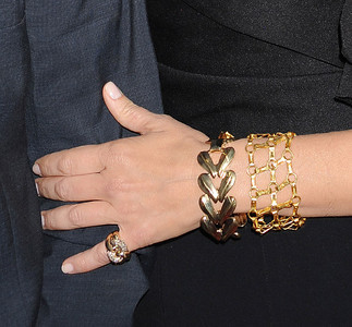 """Actress Sandra Bullock wears an Adeler 18K gold handmade chain link bracelet and a Le Vian 14K yellow gold pinky ring with brown diamonds to the premiere of """"The Change-Up"""" at the Regency Village Theatre on Aug. 1, 2011."""