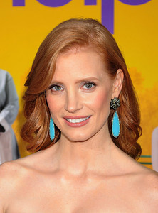 """Actress Jessica Chastain wears Sutra blackened rough diamond earrings with green sapphire and blue agate to the premiere of her film """"The Help"""" at the Academy of Motion Picture Arts and Sciences' Samuel Goldwyn Theater in Beverly Hills on Aug. 9, 2011."""