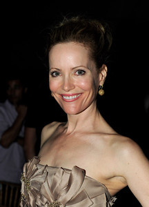 """Actress Leslie Mann wears Bavna gold diamond ball earrings to the after party for the premiere of """"The Change-Up"""" at the Hammer Museum on Aug. 1, 2011."""