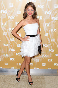Actress Sarah Hyland wears Arunashi fire opal orchid earrings with sapphires and diamonds to the Fox Emmy Nomination Celebration at Fig & Olive Melrose Place on Sept. 18, 2011.
