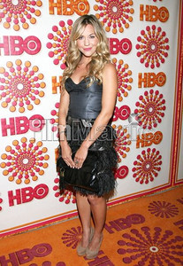 Actress Samantha Cope wears a strapless cocktail dress with beaded trim and feather skirt from Gabriela Cadena's fall collection to the HBO Emmy After Party at the Pacific Design Center on Sept. 18, 2011.