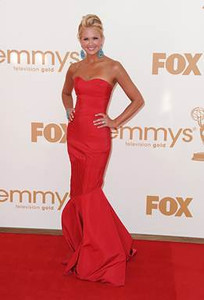 Nancy O'Dell wears Lorena Sarbu's red silk faille gown from Resort 2012 to the Primetime Emmy Awards at the Nokia Theatre on Sept. 18, 2011.