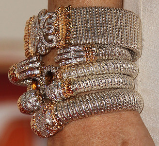 Actress Samantha Harris wears Vahan bracelets in assorted 14K gold and sterling silver diamond and a 14K gold and sterling silver citrine and diamond to the Entertainment Tonight Emmy Party at Vibiana on Sept. 18, 2011.