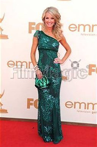 Brooke Anderson wears an emerald sequin one-shoulder gown from Lorena Sarbu's Fall 2011 collection to the Primetime Emmy Awards at the Nokia Theatre on Sept. 18, 2011.
