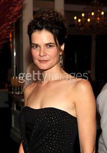 Actress Betsy Brandt wears Open Hearts by Jane Seymour two-toned double drop diamond earrings  to the AMC After Emmy Party on Sept. 18, 2011.