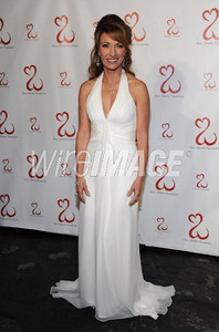 Jane Seymour celebrated her Open Hearts Foundation's inaugural gala on Feb. 19, 2011 wearing a white chiffon halter gown with ruched bodice by Pamella Roland and Open Hearts jewelry.