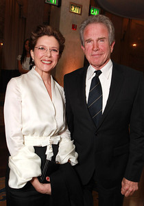 Actress Annette Bening, on the arm of husband Warren Beatty, wears a GHADAH Paris white silk bolero and black silk skirt to an Unforgettable Evening benefitting EIF's WCRF at the Beverly Wilshire Four Seasons on Feb. 10, 2011.