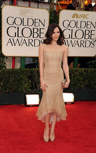 Katherine McPhee wears Amrapali 14K gold rough diamond earrings, a Diamond in the Rough Iceberg Collection ring, and an Isharya Nile Nymph pyramid ring with black rutile at the Golden Globe Awards in Beverly Hills on Jan. 15, 2012.