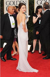 Shailene Woodley wears an embroidered illusion column dress with drape by Marchesa at the Golden Globe Awards in Beverly Hills on Jan. 15, 2012.