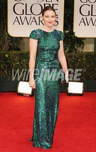 Actress Kelly MacDonald carries a black satin Party Time clutch by Swarovski at the Golden Globe Awards in Beverly Hills on Jan. 15, 2012.