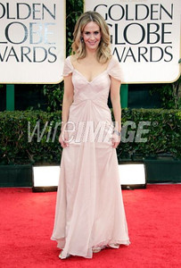 Actress Sarah Paulson wears Pamella Roland's soft pink chiffon off-the-shoulder evening gown with ruched bodice to the Golden Globe Awards in Beverly Hills on Jan. 15, 2012.