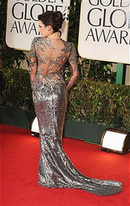 Actress Lea Michele wears an antique embroidered illusion dress by Marchesa to the Golden Globe Awards in Beverly Hills on Jan. 15, 2012.