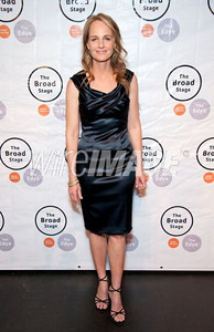 """Actress Helen Hunt wears a navy satin sheath dress with draped neckline by David Meister to the premiere of her play, """"Our Town,"""" on the Broad Stage at the Santa Monica College Performing Arts Center on Jan. 18, 2012."""