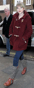 Singer Taylor Swift wears a Topshop maroon hooded toggle coat in London.