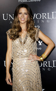 """Actress Kate Beckinsale wears a gold cap-sleeve sequin-encrusted gown with a crystal cowl neckline from Jenny Packham's Spring/Summer 2012 catwalk collection to the premiere of """"Underworld: Awakening"""" at Grauman's Chinese Theatre on Jan. 19, 2012. Beckinsale accessorizes with Amrapali 18K gold diamond earrings and three Amrapali cuffs in 18K thin gold and diamond, 18K mesh gold leaf and 18K gold diamond."""