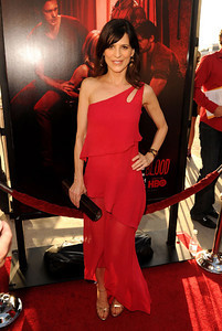 """Actress Perrey Reeves wears a Victor Velyan garnet marquise cut-out cuff and Victor Velyan drop earrings with white sapphires to the premiere of """"True Blood"""" Season 4 at ArcLight Cinemas Cinerama Dome on June 21, 2011. Reeves carries an M.C.L. by Matthew Campbell Laurenza Jackie handbag."""