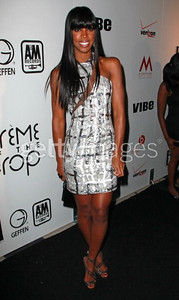 Kelly Rowland wears a silver sequined and beaded asymmetrical dress with nude inserts from Edition by Georges Chakra to the Post BET Awards Celebration at Mr Chow in Beverly Hills on June 26, 2011.