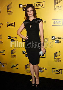 """Actress Betsy Brandt wears David Meister's black beaded cap sleeve dress to the Season 4 premiere of her show, """"Breaking Bad,"""" at the Chinese 6 Theatres on June 28, 2011. Brandt accessorizes with an Indian sapphire crystal Swarovski clutch."""
