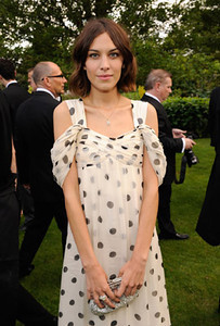 Actress Alexa Chung wears a Toi & Moi ring in white gold set with diamonds, a Chopard fancy-cut diamond bracelet and a Happy Diamond teddy bear pendant to Elton John's White Tie and Tiara ball in London on June 23, 2011.
