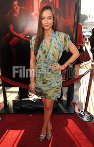 """New cast member Courtney Ford wears a blue and green silk chiffon printed V-front cocktail dress by Catherine Malandrino to the premiere of """"True Blood"""" Season 4 at ArcLight Cinemas Cinerama Dome on June 21, 2011. Ford accessorizes with M.C.L. by Matthew Campbell Laurenza sapphire earrings and an Adeler 14K white gold ring with Australian boulder opal."""