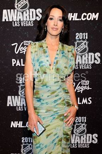 Actress Jennifer Beals wears a blue and green silk chiffon printed V-front gown with gathering detail by Catherine Malandrino to the 2011 NHL Awards on June 22, 2011. Beals accessorizes with a Swarovski silver Kiosque, three Swarovski bangles and a Daniel Swarovski statement ring.