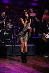 """Selena Gomez wears a hand-beaded ombre fringe silk dress by Anthony Franco to perform on """"Late Night with Jimmy Fallon"""" on June 23, 2011."""